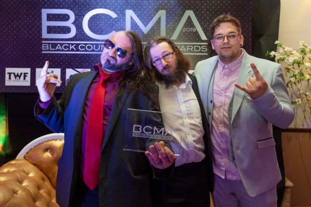 Halesowen News: WEAK13 frontman Nick J Townsend, with bass player Wesley Smith and drummer Justin James, who appeared in the video, at the awards ceremony