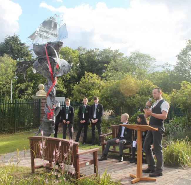 left to right: Samuel Thomas, Tyler Smith, Sam Mannings, Ben Bishop, Rabia Rehman and Luke Perry who created the sculpture. Picture: Redhill School