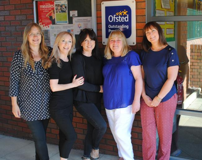 Staff from Greenfield Pre-School celebrate receiving an 'outstanding' rating from OFSTED
