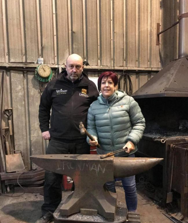 FUNDRAISING: Steve Ellis Cooper, blacksmith, with Sue Cosnett who is raising money for the memorial