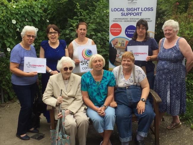 Sight Concern clients and volunteers celebrating the National Lottery funding
