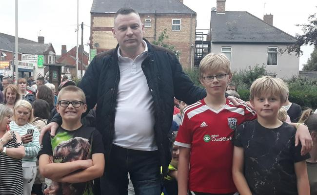 Lye trader Gary Farmer at the community gathering with Alfie, Liam and Nathan Jackson