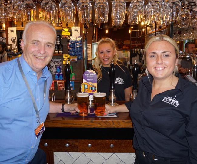Andy Camp, commercial director of West Midlands Railway and Ashleigh Bourne from Sadler's Brewery