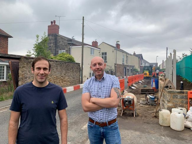 Councillor Kieran Casey and councillor Adam Aston at the site of the works on Vale Street.