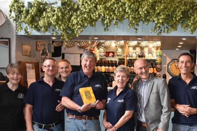 CAMRA branch vice chairman Nick Rubery with the Brewery Tap's Dave Carr and his team