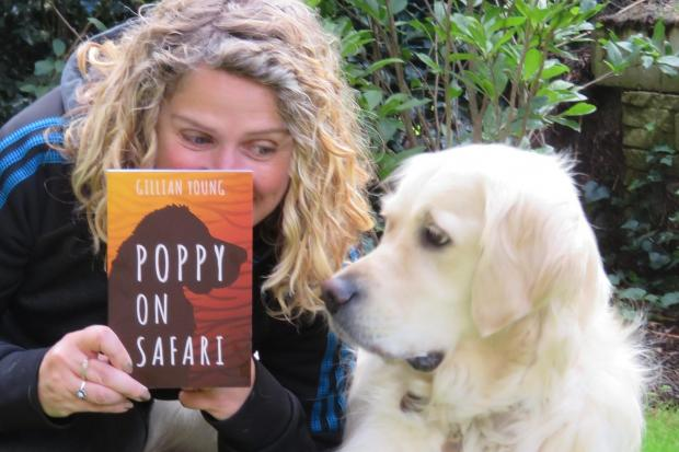 Bewdley author Gillian Young with her pet dog Poppy and the new book