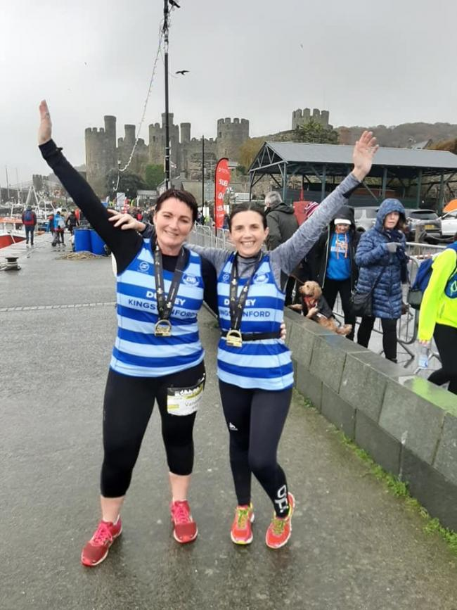 Vanessa Harris and Farrah Hunter-Coley with medals after finishing the Conwy half marathon
