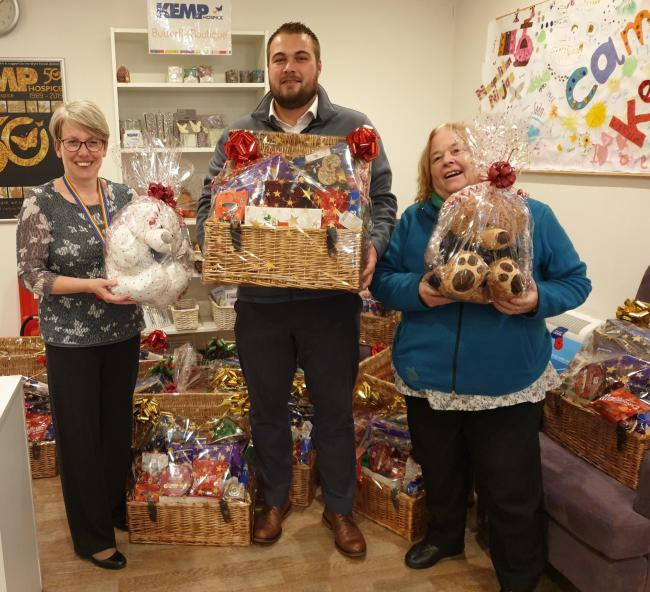 Danny Maddox and Bernadette Connor, from Stourport Midcounties Co-operative, delivering Christmas hampers to KEMP Hospice