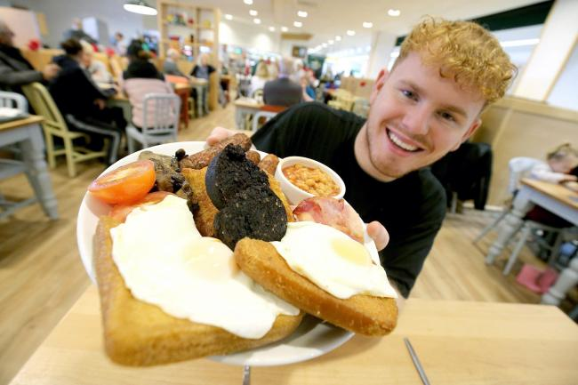 Customer Robert Trigg tries the Morrisons Black Fry-Day breakfast. Photo credit should read: Nigel Roddis/PA Wire