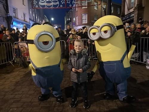 The Minions at the Stourbridge Christmas lights switch on with competition winner Ashley Knott, aged five. Pic - Dudley Council