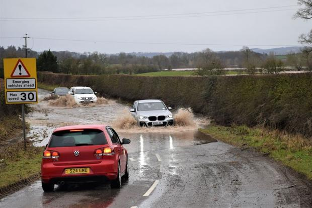 Halesowen News: Storm Dennis flooding on the road between Craven Arms and Leintwardine today. Picture: John Savery