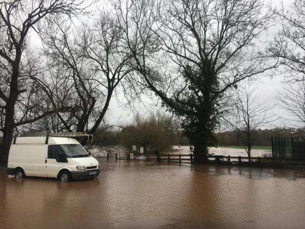 Halesowen News: The road leading to Ross-on-Wye Rowing Club is submerged by Storm Dennis floodwaters. Picture: Carmelo Garcia