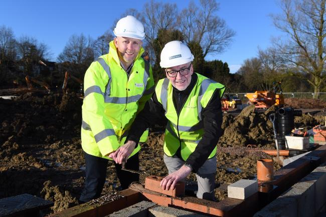 Matt Crucefix, from Stonewater, and Phil Morgan, from Living Space Housing, laying the first bricks at the old Victoria Carpets sports ground in Kidderminster