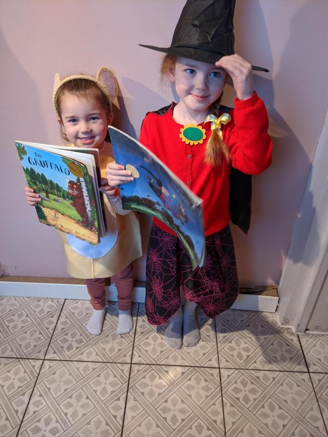 Jennifer and Charlotte dressing up as characters from their favourite books.