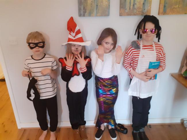 Here are my 4 little ones. Lewis as a robber! Lexi as Cat in the hat, Olivia as a bad mermaid and Harvey as Ratburger.
