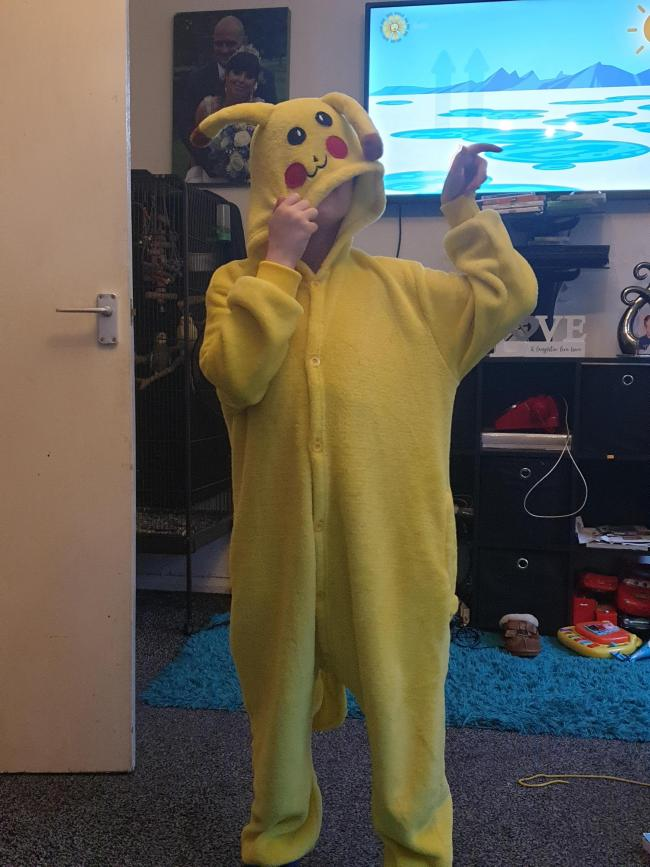 Riley aged 3 ready for nursery dressed as mr fox.  Tyler-James aged 7 dressed in pikachu onesie for world book day at woodsetton special school.