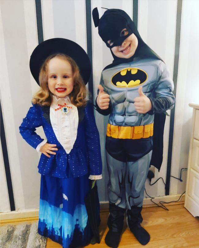 My beautiful daughter skyla-Rose  looking supercalifragalisticespialidocious  Standing  proud next to her big brother Lawson with two big thumps up as Batman for world book day