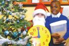Santa Claus and Reddall Hill Primary School pupil Wellington Takundwa look forward to this weekend's Christmas Fair.