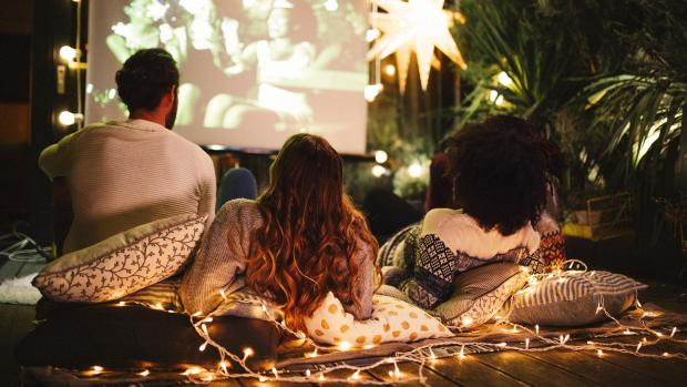 Halesowen News: Sit back and relax with a projector and outdoor screen. Credit: Getty Images / M_A_Y_A