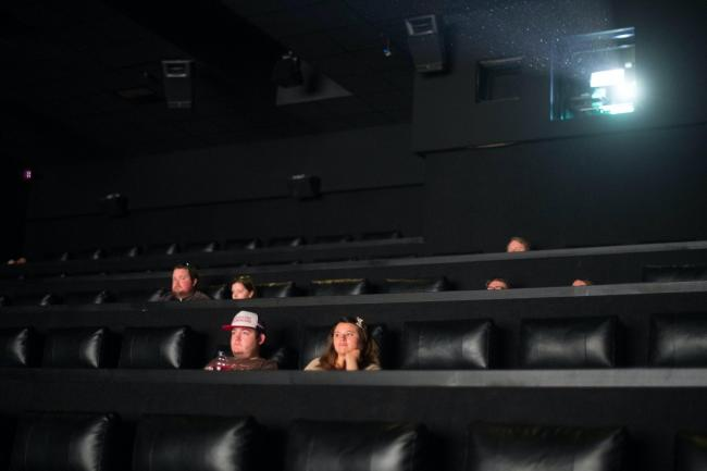 Film goers at the Showcase Cinema at Bluewater in Kent sit down, socially distanced, to watch a film on Saturday July 4