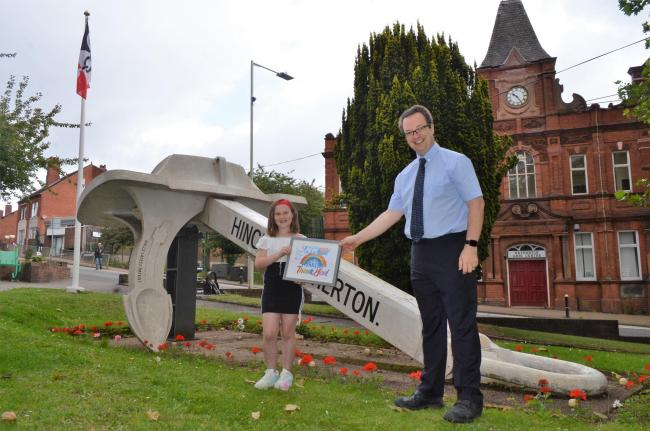 Mike Wood MP pictured handing Emily Tucker a framed copy of her winning poster competition entry – signed by the Prime Minister