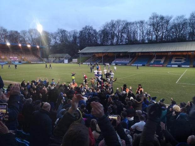 Halesowen News: Halesowen players and fans celebrate a win at Halifax earlier in their FA Trophy run. Picture: Matt Russell.