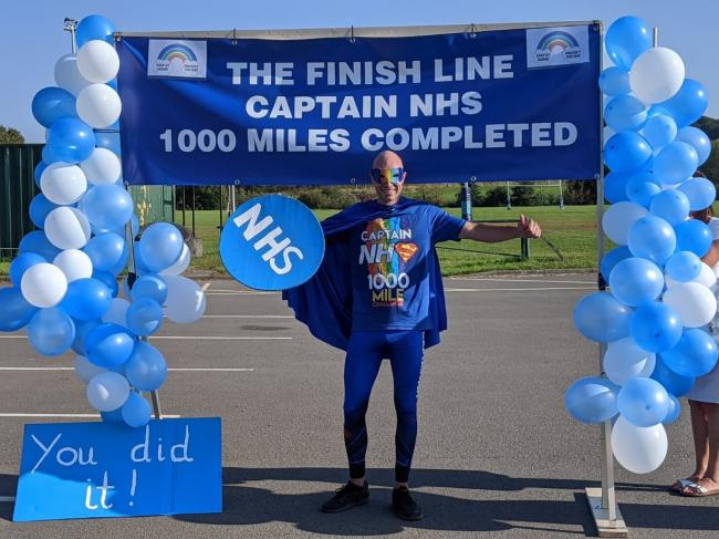 Iain Gillett, aka Captain NHS, completed his 1,000th and final mile of the challenge in Kingswinford on September 13.