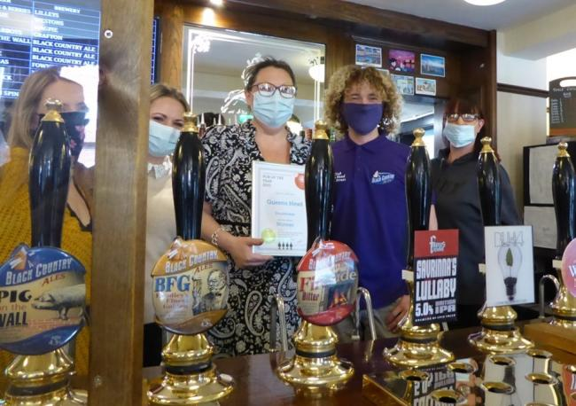 Jo Cundale, centre, with her hard-working team at The Queen's Head