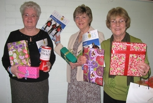 L-R: Margaret Parton, Celia Wilkie and Chris Johnson with the Mother's Day gifts on sale.