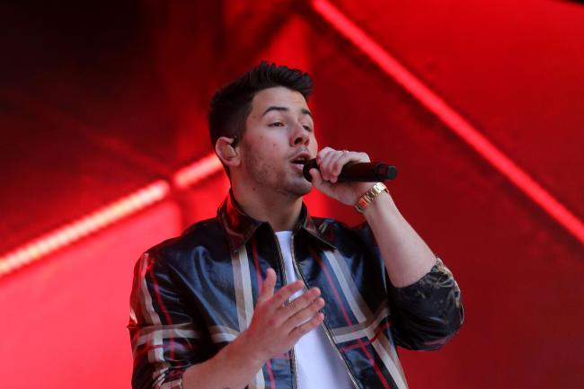 Nick Jonas singing on stage