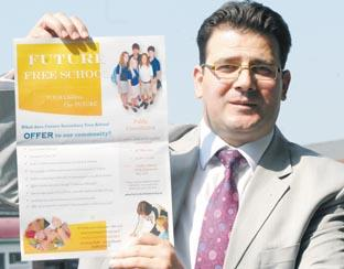 Future Education Trust director Mustafa Erol with a poster for a forthcoming public consultation meeting.