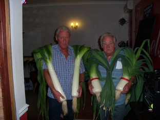 Mick Poultney and Norman Soper with their prize winnin