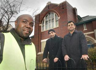 Toby Ephram with Syed Mangour Ahmad and Fareed Ahmad outside their new property