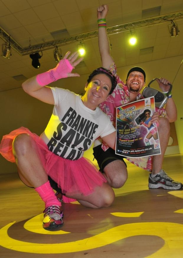 """Fitness Instructor Helen Hill and Gym Instructor Matt Honeyghan give their retro outfits a test run at Haden Hill Leisure Centre."""