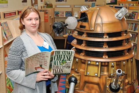 Brierley Hill Library volunteer Rachael Platt reads to a dalek. Buy photo: 301214LA