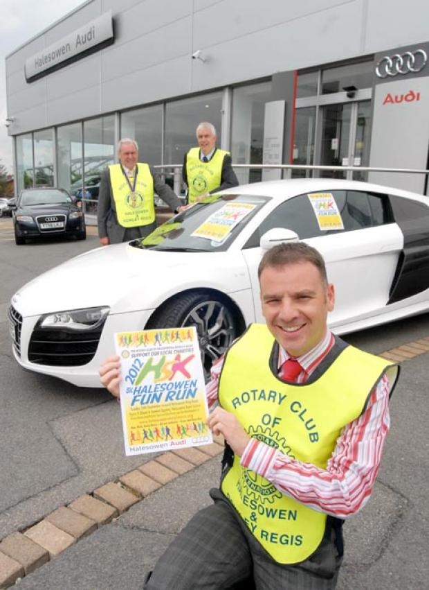 David Matty, Cllr Ken Turner and Stephen Jones celebrate Audi sponsoring the Halesowen Fun Run. (buyphoto 321247M)