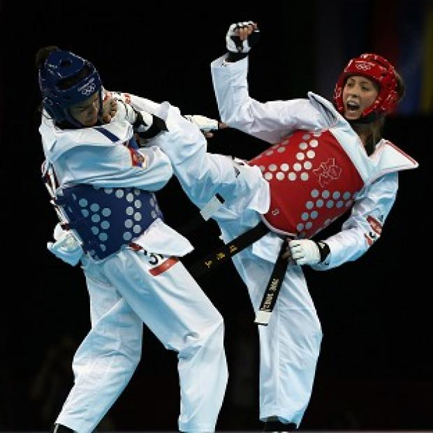 Jade Jones, right, pulled off a comprehensive 13-3 win