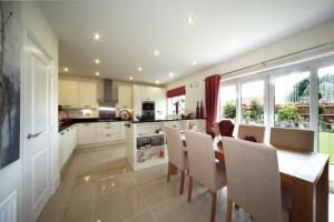 The Salisbury show home enjoys a convivial open plan layout and well equipped kitchen.