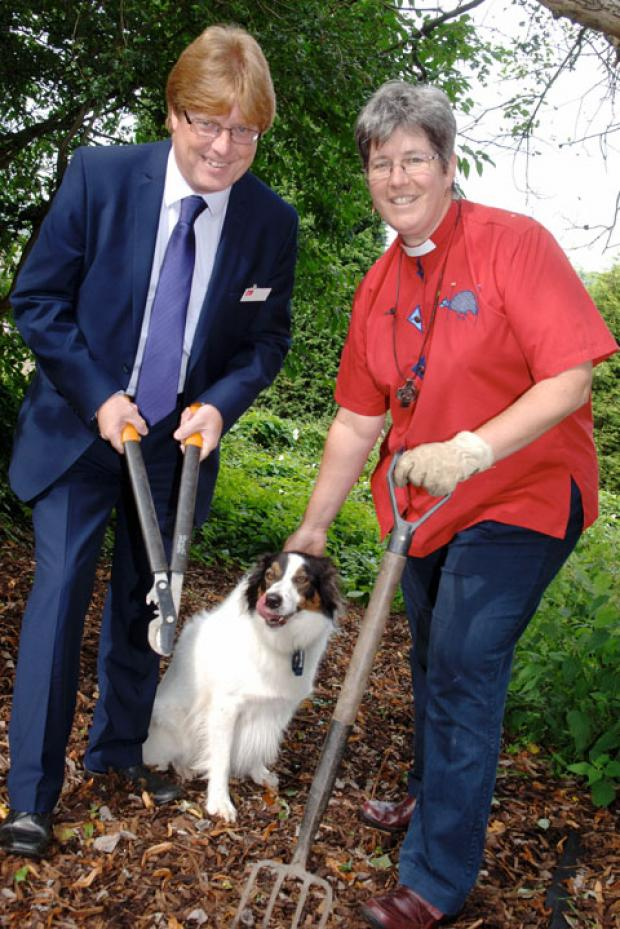 Phil Hunt from Business in the Community and Katrynn Leclezio and Tilly at the site of the new memorial meadow. 371209LA