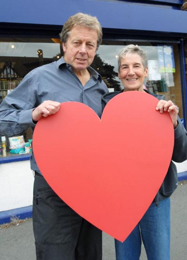 Pharmacist Clive Turner and customer Val Ward. (To buy:371257M)