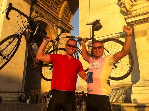 Jonathan White (right) and fellow cyclist Glen Callow cellebrate reaching the Arch de Triomphe.