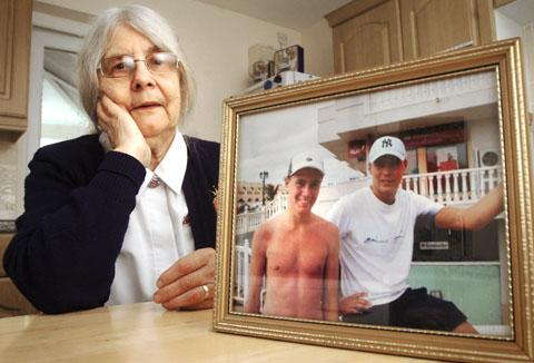 Betty Walker with photo of Luke (left) & his brother Ryan. Buy photo: 421239L