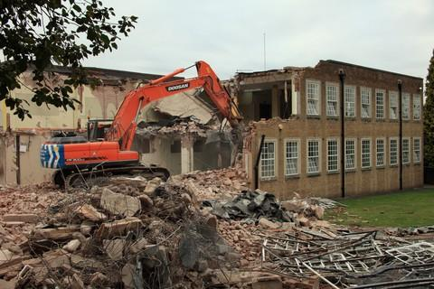 A bulldozer demolishes Cradley Heath's iconic Municipal Buildings. Picture by Pete Lopeman.