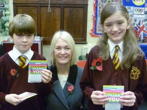 Competition winners Thomas Howell and Rachel Harris with Margot James MP.