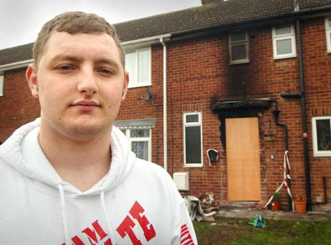 Josh Burford outside the arson-hit house.