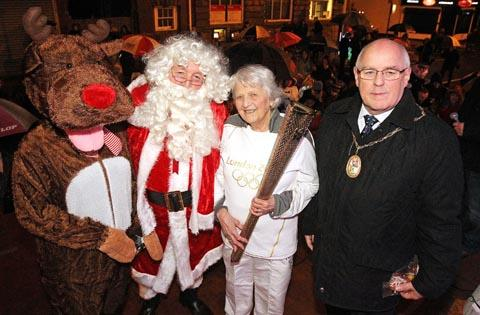 Halesowen News: Rudolf the reindeer with Santa Olympic torchbearer Jessica Gripton and Sandwell's deputy mayor Cllr Vic Silvester.(To buy:491239J)