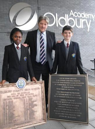 Tashara Stewart, aged 11, headteacher John Martin and Cameron Dallow, aged 11 at Oldbury Academy.