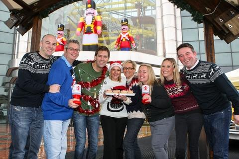 Mall staff and shoppers don festive knits to help Save the Children