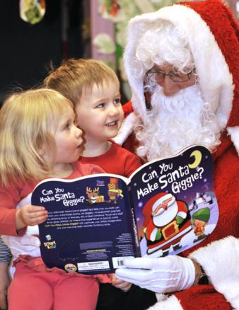 Santa with Summer Bond, aged two, and Finlay Carroll, aged three. (To buy:521219L)