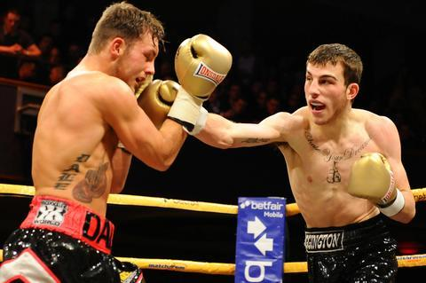 Sam Eggington in action against Dale Evans. Photo by Leigh Dawney.
